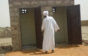 Leader of the community Abakr Abdallah, inspecting the newly constructed toilets. Photo: UNMIS